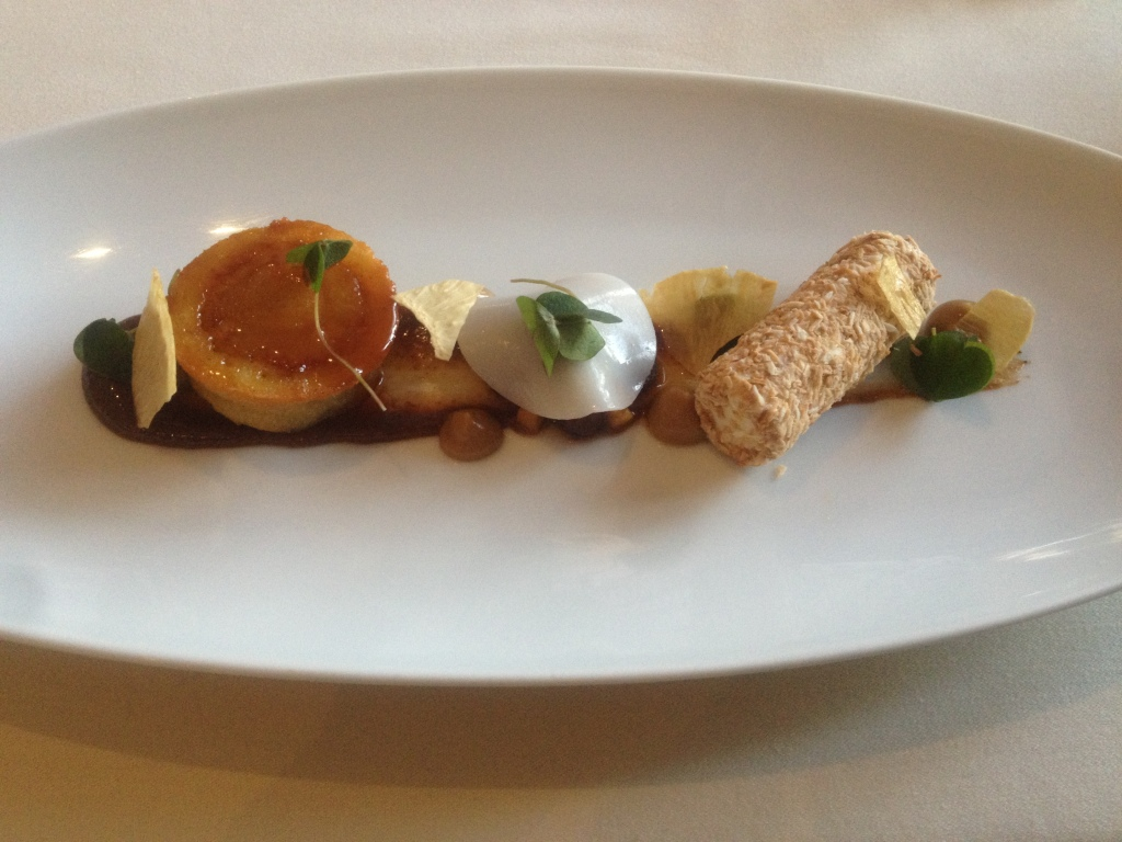 Warm pineapple cake, coconut parfait, rum and raisin puree