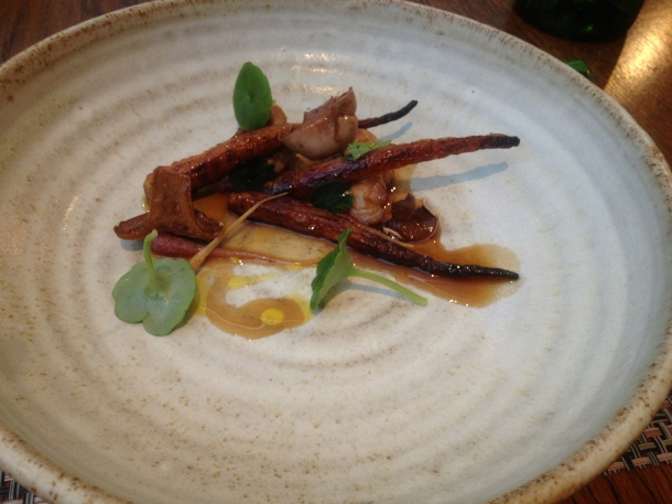 Grilled carrots and lamb sweetbreads, juniper and mulled cider