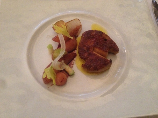 Pan roasted duck foie gras from Les Landes with a crust of ginger bread, caramelised winter fruits and porto reduction