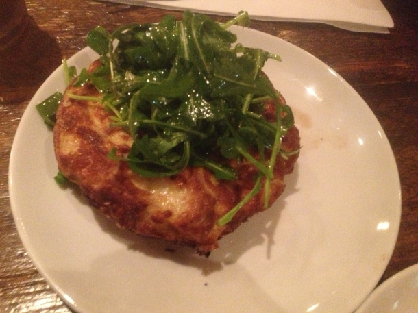 Potato and onion tortilla with rocket