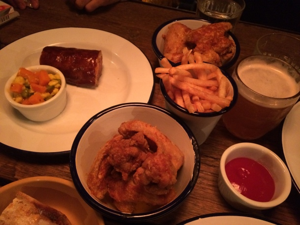 Chicken wings, fries and sausage roll at Barnyard