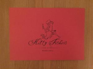 Kkitty Fisher's business card